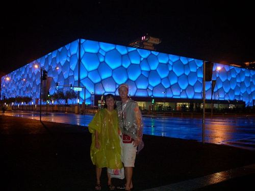 Outside the Water Cube on a rainy evening