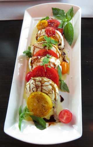 Tomato salad with buffalo milk mozzarella, photo by Mike Keenan