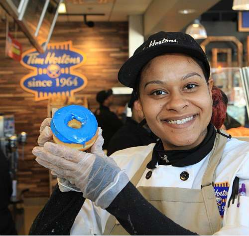 Tim Hortons Baker, Carmen Johnson shows us one of her donuts baked in the new Canalside