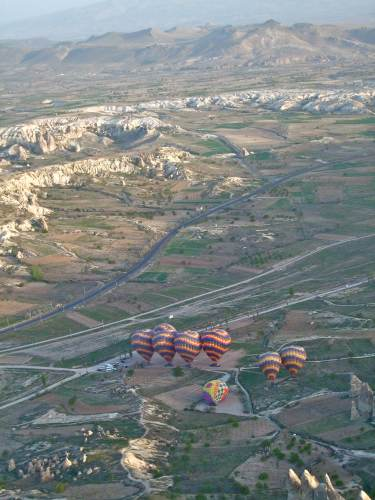 Dozens Of Balloons Above Cappadocia Fairy Chimneys