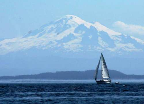 Sailboat Under The Looming Mount Baker