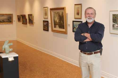 Owner of Earls Court Gallery on Ottawa Street North, Bob Daniels proudly shows off his gallery