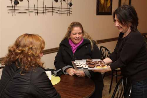 Zorka Misic serves up some gluten free pastries at Sestres Pastry and Coffee Shop