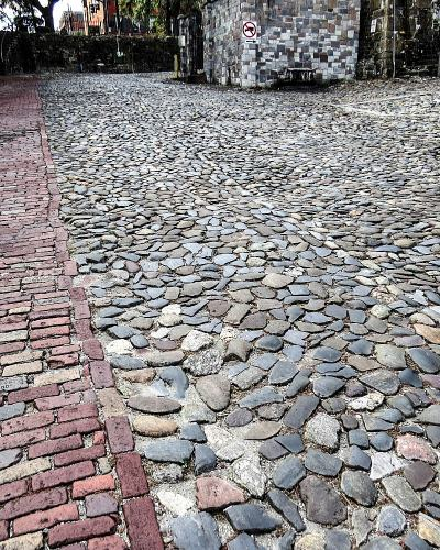 Ship Ballast Rocks used as cobblestone, photo by Mike Keenan