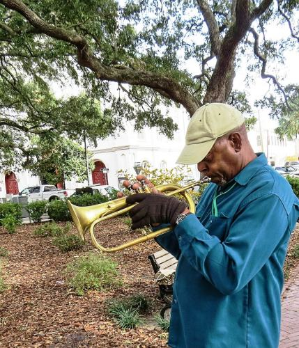 Trumpet Player in Square, photo by Mike Keenan