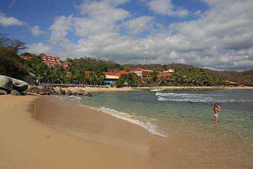 Ventura Beach, Huatulco, Mexico. The Las Brisas Hotel can by seen in the distance
