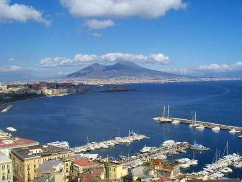 Naples (a view over the city, showing the Vesuvius), photo by Wikimedia Commons