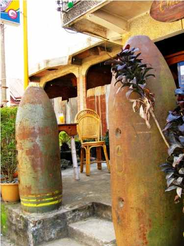 Cafe Entrance With Bomb Casings