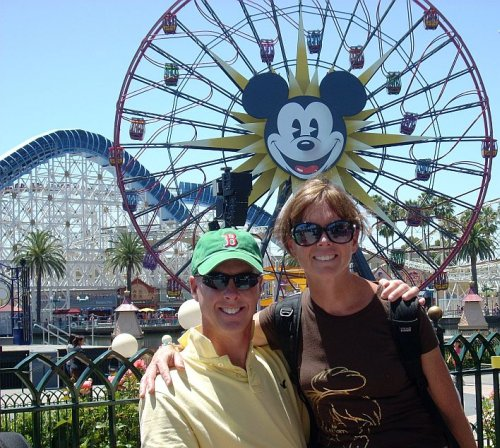 Kathy and Fred Masters in front of Mickeys Fun Wheel and the California Screamin Roller Coaster at Disneys California Adventure