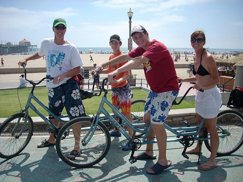 Renting tandem bikes along the beach front at Huntington Beach, California