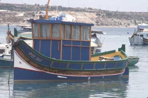 Fishing boats at anchor in Marsaxlokk harbor - Photo by Burt Fine