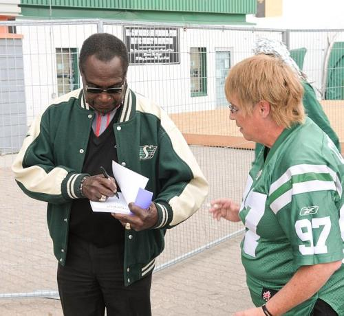 Football Legend George Reed Signing Autograph
