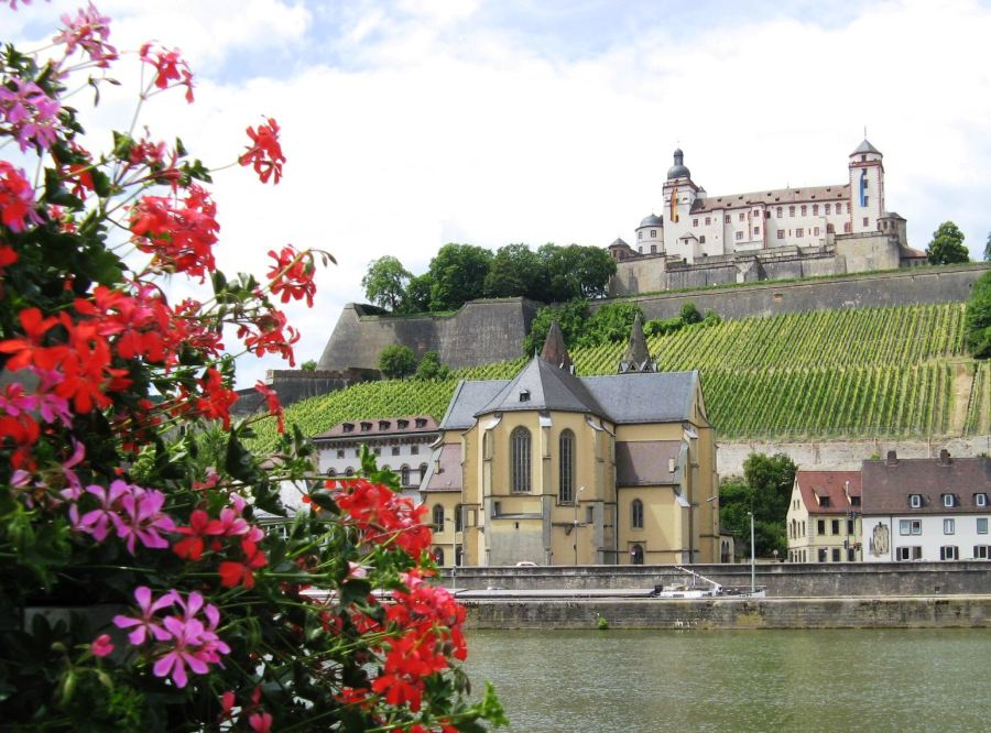 The Rhine, beautiful flowers, hillside vineyards, a quaint village church and a magnificent castle. Photo by Tom Douglas