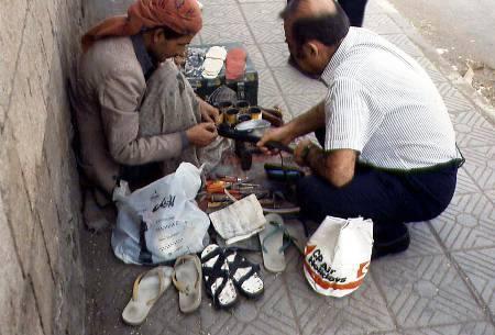 Street Shoemaker Repairing Tourist Belt