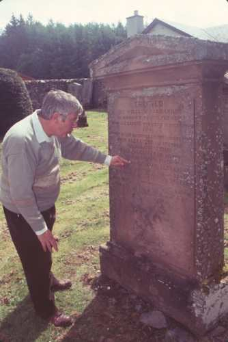 David Roseburgh reads an ancient tombstone - Photo by Burt Fine