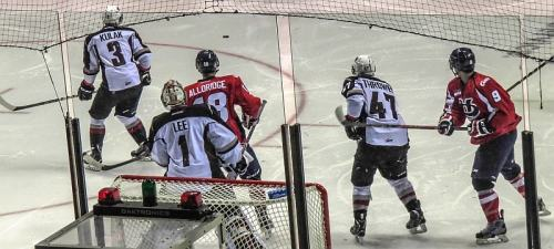 Action in front of Giants net, photo by Mike Keenan