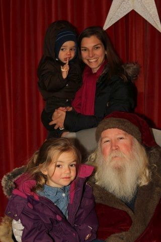 The Brodie family enjoy having a free photograph taken with Father Christmas