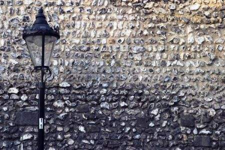 Old Fashioned Lamp Post And Flint Stone Wall