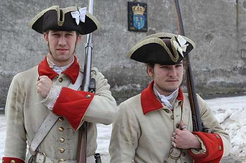 Two students portray French soldiers from the 1750s