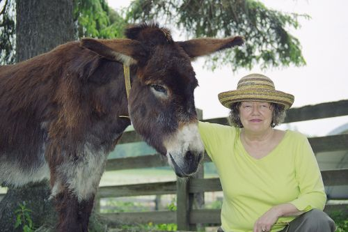 Sandra Prady, founder of the Donkey Sanctuary of Canada and one of her beloved donkeys