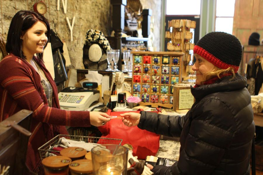 Ellen Bailey makes a purchase from the Epiphany Gift Shop