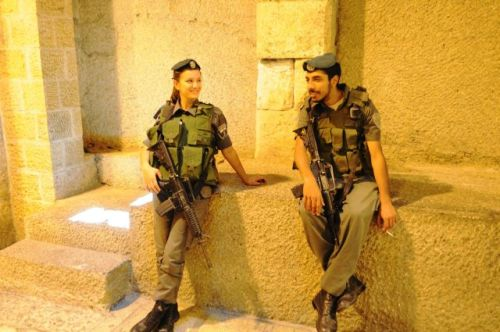 Soldiers relaxing in Jerusalem, photo by Mike Keenan