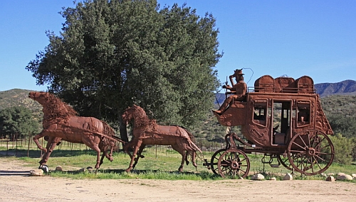 Stagecoach sculpture just outside the city